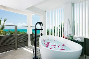 Each also features an outdoor shower or tub with views of Provos' north shore.