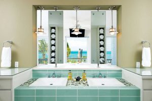 Guests can even enjoy the ocean view from the bathroom vanity.