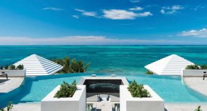 Cascade terraces over three levels. Each bedroom offers direct access to either a swiming pool or the beach.